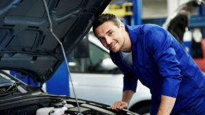 Portrait of an experienced mechanic about to examine a car's engine at his workshop - Copyspace